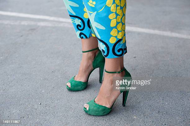 Laure Heriard Dubreuil store owner wearing Pierre Hardy shoes and a vintage YSL jumpsuit at Paris Fashion Week Spring/Summer 2013 menswear shows on...