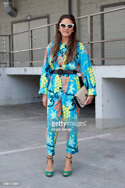 Laure Heriard Dubreuil store owner wearing Pierre Hardy shoes vintage YSL jumpsuit Balenciaga bag and Tom Ford sunglasses at Paris Fashion Week...