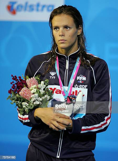 Laure Manaudou of France stands on the podium after receiving her silver medal in the Women's 800m Freestyle Final during the XII FINA World...