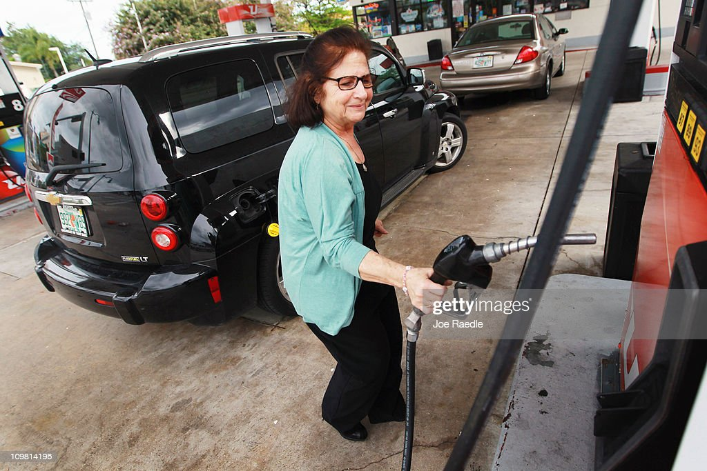 Laure (no surname given) pumps gas at the Ugas station March 6, 2011 in Miami, Florida. The national average for a gallon of self-serve, regular gas was $3.50 a .33 cent increase from two weeks ago. This was the second largest two-week jump in gas prices ever, largely due to the events unfolding in Libya.