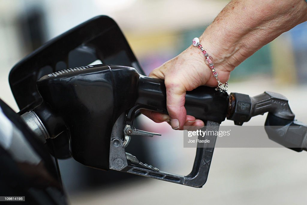 Laure (no surname given) pumps gas at the Ugas station March 6, 2011 in Miami, Florida.The national average for a gallon of self-serve, regular gas was $3.50 a .33 cent increase from two weeks ago. This was the second largest two-week jump in gas prices ever, largely due to the events unfolding in Libya.
