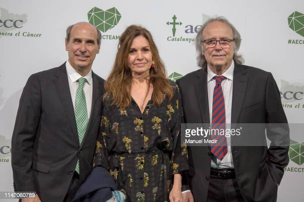 Laureano Molins Candela Tiffon and Juan Manuel Serrat in the charity dinner to raise funds against cancer on April 11 2019 in Barcelona Spain