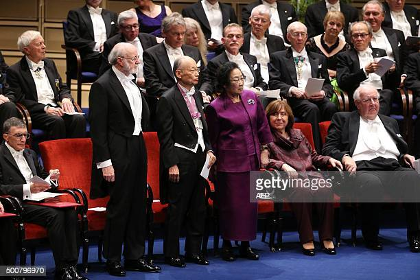 Laureates of the 2015 Nobel Prize in Physiology or Medicine Irish William C Campbell Japanese Satoshi Omura and Chinese Youyou Tu get up to receive...