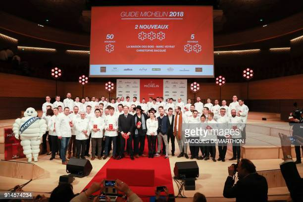 Laureates pose at the end of the Michelin guide award ceremony at La Seine Musicale in BoulogneBillancourt near Paris on February 5 2018 / AFP PHOTO...