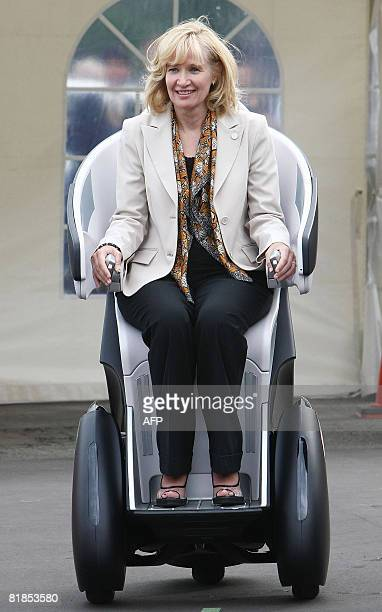 """Laureen Harper, wife of Canadian Prime Minister Stephen Harper tries out Toyota Motor Corporation's Personal Mobility """"i-REAL"""" during a concept car..."""