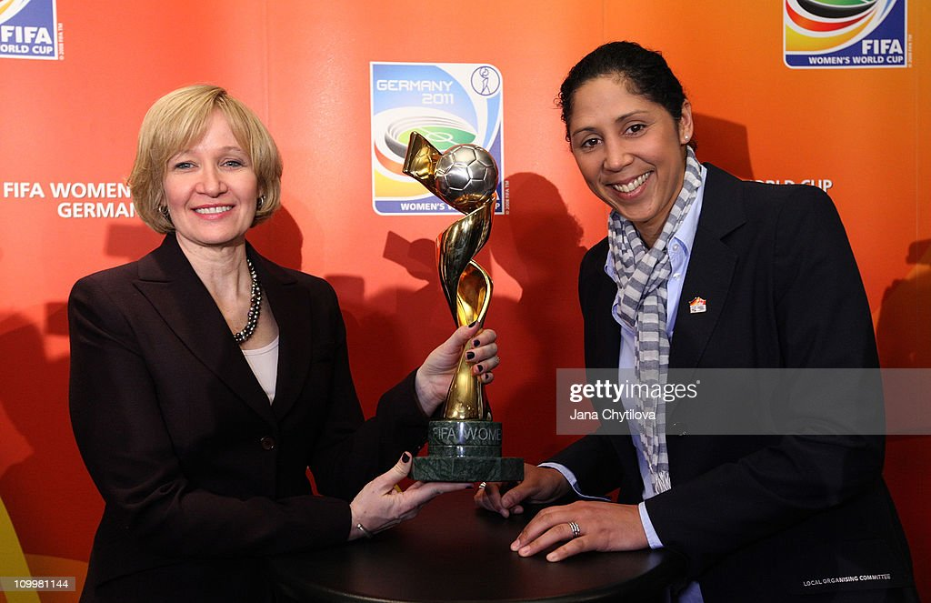 Laureen Harper (L), wife of the Prime Minister of Canada poses with Steffi Jones, Organising Committee President's of Women's World Cup 2011 and the Womens World cup trophy during the FIFA Women's World Cup Welcome Tour on March 11, 2011 in Ottawa, Ontario, Canada.