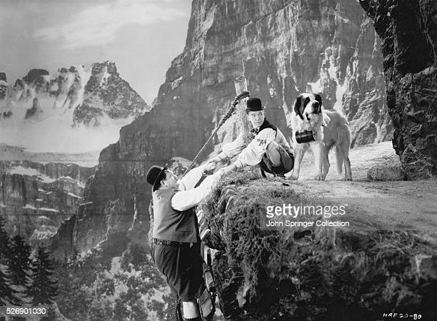 Laurel and Hardy climb a mountain in the 1938 film Swiss Miss