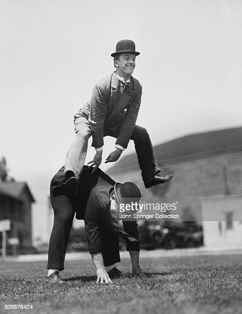 Laurel and Hardy Playing Leap Frog