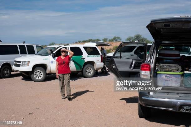 Laurel Grindy a volunteer with Green ValleySahuarita Samaritans checks out Border Patrol activity before heading out on a volunteer patrol to search...