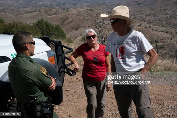 Laurel Grindy and Paul Nixon both volunteers with Green ValleySahuarita Samaritans speak to a Border Patrol agent who was manning surveillance...