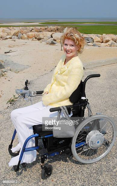 Laurel Labdon a paraplegic poses on her wheelchair in a beach parking lot near her Cape Cod home in Brewster Massachusetts on Monday June 19 2006...