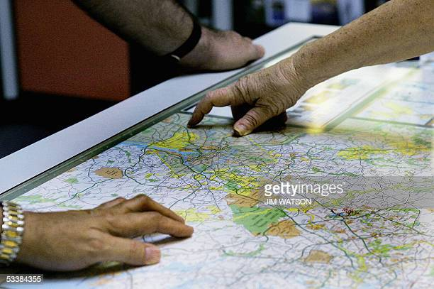 Travellers at a Laurel Maryland rest stop look at a map 13 August in an attampt to avoid a sevenmile twohour jam caused by construction of a new...