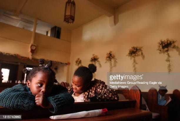 Lauren A. LittleMay 8, 2005Pentecostal Church, Christ is RisenNorah Vallon and her sister Deborah Vallon both of Reading, wait for the service to...