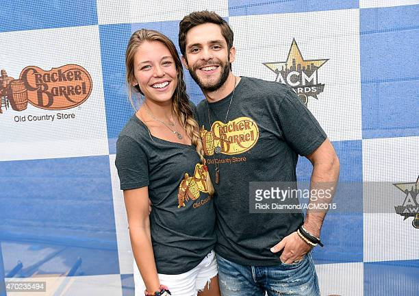 Lauren Akins and singersongwriter Thomas Rhett attend the Cracker Barrel Old Country Store Country Checkers Challenge at Globe Life Park in Arlington...