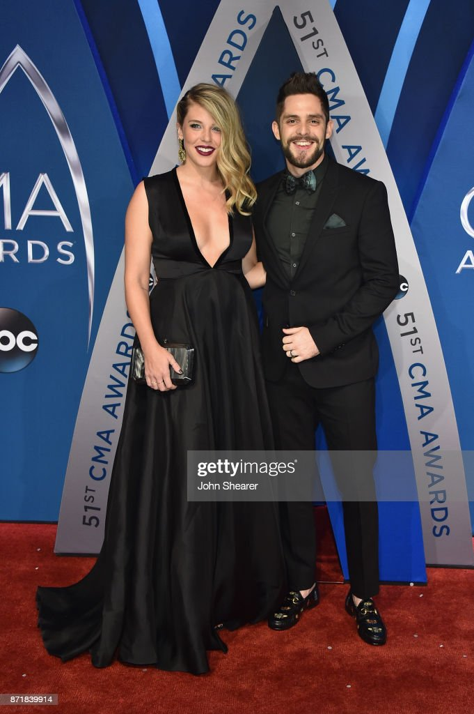 Lauren Akins and singer-songwriter Thomas Rhett attends the 51st annual CMA Awards at the Bridgestone Arena on November 8, 2017 in Nashville, Tennessee.