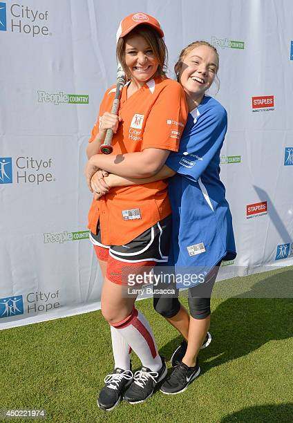 Lauren Alaina and Danielle Bradbery attend the City of Hope Celebrity Softball Game during the CMA Festival at Greer Stadium on June 7 2014 in...