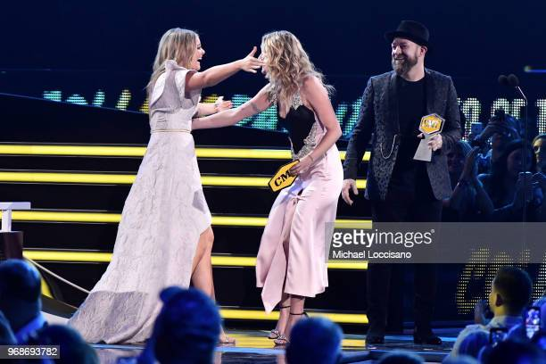 Lauren Alaina Jennifer Nettles and Kristian Bush of Sugarland speak onstage at the 2018 CMT Music Awards at Bridgestone Arena on June 6 2018 in...