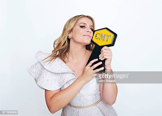 Lauren Alaina poses with CMT Award at the 2018 CMT Music Awards Show Portrait Studio at Bridgestone Arena on June 6 2018 in Nashville Tennessee