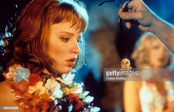 Lauren Ambrose is presented a tiny skull in a scene from the film 'Psycho Beach Party' 2000