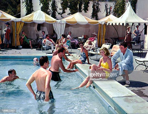 Lauren Bacall and Gregory Peck poolside in a scene from the film 'Designing Woman', 1957.