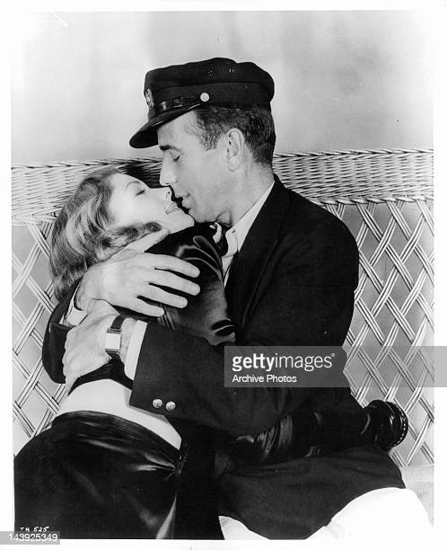 Lauren Bacall is embraced by Humphrey Bogart in a scene from the film 'To Have And Have Not' 1944