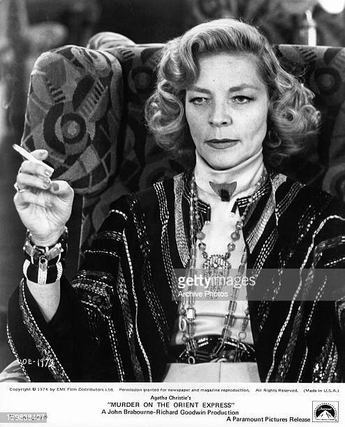 Lauren Bacall smokes a cigarette in a scene from the film 'Murder On The Orient Express' 1974