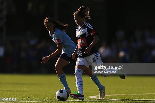 Lauren Barnes of the Victory runs with the ball during the round four WLeague match between Sydney and Melbourne at Lambert Park on October 6 2014 in...
