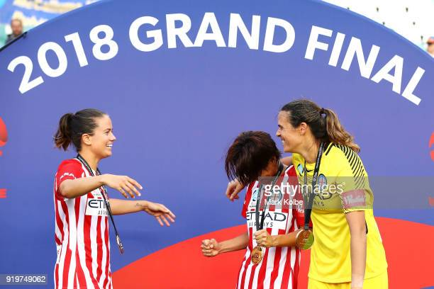 Lauren Barnes Yukari Kinga and Lydia Williams of Melbourne City celebrate victory during the WLeague Grand Final match betweenSydney FC and Melbourne...