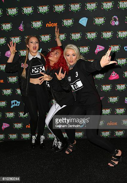 Lauren Bennett Natasha Slayton and Jazzy Mejiaon of GRL pose the media wall ahead of the Nickelodeon Slimefest 2016 evening show at Margaret Court...