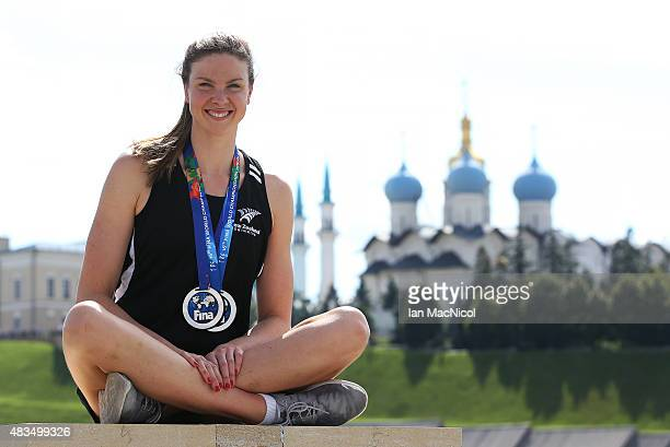 Lauren Boyle of New Zealand poses with her two silver medals in front of the Kul Sharif Mosque during day Sixteen of The 16th FINA World Swimming...