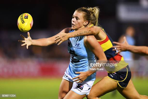 Lauren Brazzale of Carlton tackled by Deni Varnhagen of the Adelaide Crows during the round five AFLW match between the Adelaide Crows and the...