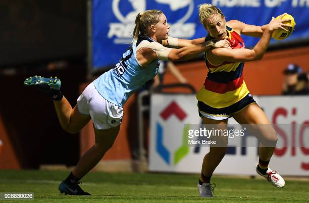Lauren Brazzale of Carlton tackles Talia Radan of the Adelaide Crows during the round five AFLW match between the Adelaide Crows and the Carlton...