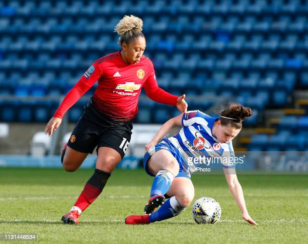 Lauren Bruton of Reading FC Women holds of Lauren James of Manchester United Women during The SSE Womens FA Cup Quarter Final match between Reading...