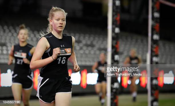 Lauren Bulter performs in the 2km time trial during the AFLW Draft Combine at Marvel Stadium on October 3 2018 in Melbourne Australia