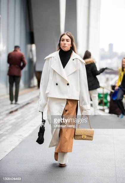 Lauren Caruso is seen wearing white cropped jacket white brown two tone skirt beige Chanel bag outside Carolina Herrera during New York Fashion Week...