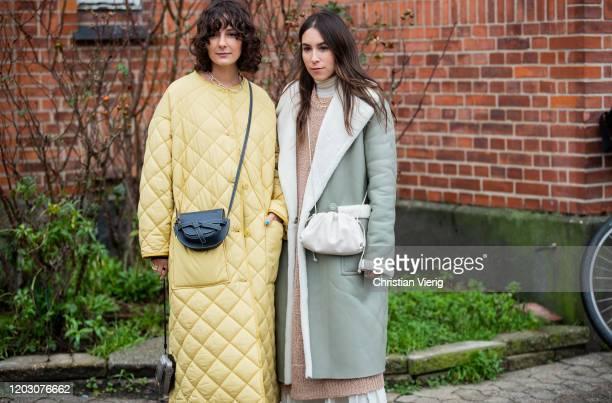 Lauren Caruso wearing green shearling coat and Alyssa Coscarelli wearing yellow puffer coat seen outside By Malene Birger during Copenhagen Fashion...