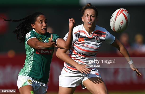 Lauren Cattell of England and Edna Santini of Brazil watch the ball during day one of the Emirates Dubai Rugby Sevens HSBC World Rugby Women's Sevens...