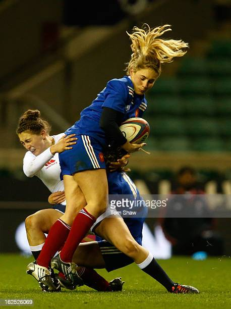Lauren Cattell of England tackles Marjorie Mayans of France during the Women's RBS Six Nations match between England and France at Twickenham Stadium...