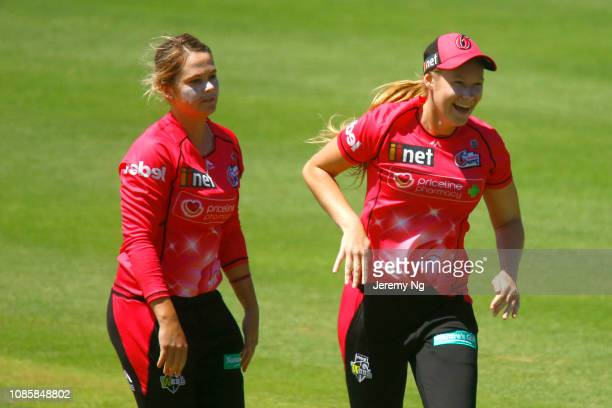 Lauren Cheatle and Dane van Niekerk of the Sixers celebrate a wicket during the Women's Big Bash League match between the Sydney Sixers and the...