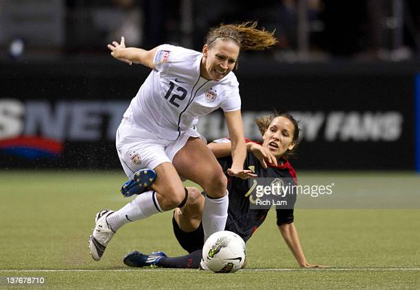 Lauren Cheney of the United States reacts after getting a high tackle from Jenifer Ruiz of Mexico during second half of the 2012 CONCACAF Women's...