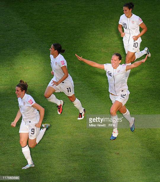 Lauren Cheney of USA celebrates with team mates Heather O'Reilly Alex Krieger and Carli Lloyd after scoring during the FIFA Women's World Cup 2011...