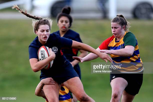 Lauren Christie of Southland Girls is tackled during the Southland Secondary School Girls Final match between Southland Girls High School v Eastern...