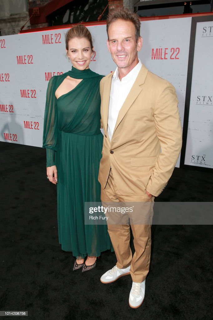 Lauren Cohan (L) and Peter Berg attend the premiere of STX Films' 'Mile 22' at Westwood Village Theatre on August 9, 2018 in Westwood, California.