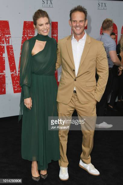 """Lauren Cohan and Peter Berg attend the premiere of STX Films' """"Mile 22"""" at Westwood Village Theatre on August 9, 2018 in Westwood, California."""