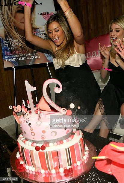 ACCESS*** Lauren Conrad and Heidi Montag laugh as mark celebrates new spokesperson Lauren Conrad's 21st birthday at Area on February 1 2007 in West...