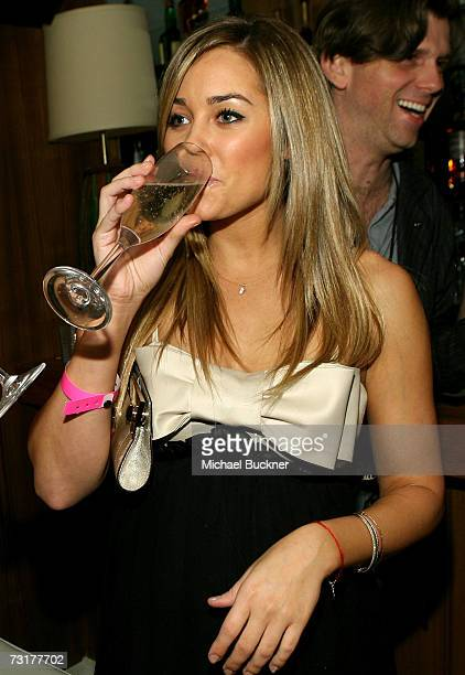 ACCESS*** Lauren Conrad drinks champagne as mark celebrates new spokesperson Lauren Conrad's 21st birthday at Area on February 1 2007 in West...