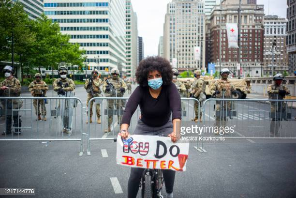 Lauren Coursey protests in front of a line of Pennsylvania National Guard outside City Hall on May 31 2020 in Philadelphia Pennsylvania Protests and...