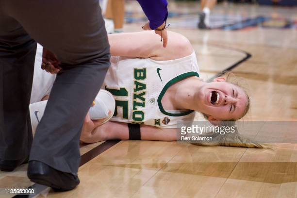 Lauren Cox of the Baylor Bears reacts to hurting her knee against the Notre Dame Fighting Irish at Amalie Arena on April 7 2019 in Tampa Florida