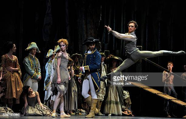 Lauren Cuthbertson as Manon, Bennet Gartside as The Goaler and Sergei Polunin as Des Grieux with artists of the company in the Royal Ballet's...
