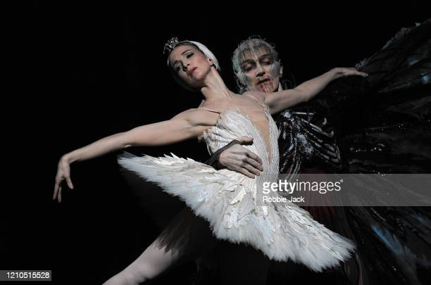 Lauren Cuthbertson as Odette/Odile and Gary Avis as Von Rothbart in The Royal Ballet's production of Lev Ivanov and Marius Petipa's Swan Lake with...
